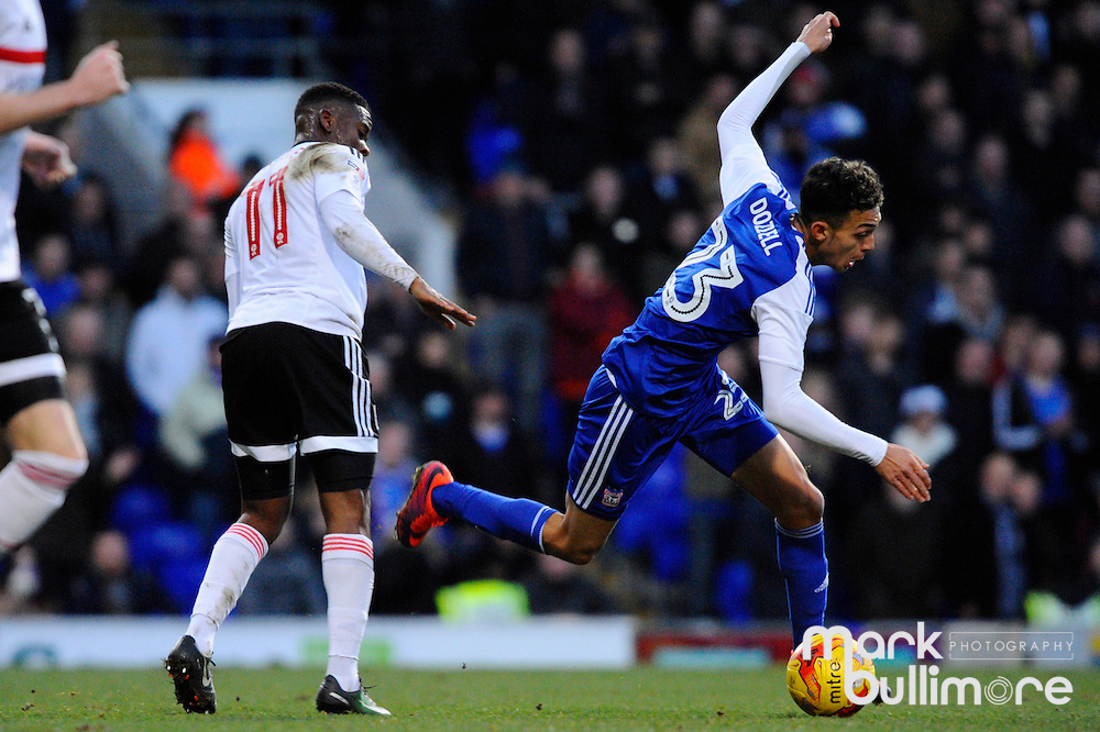 Ipswich, Suffolk. Football action from Ipswich Town v Fulham at Portman Road in the Sky Bet Championship on the 26th December 2016. Fulham's Floyd Ayit&eacute; and Ipswich player Andre Dozzell.<br /> <br /> Picture: MARK BULLIMORE