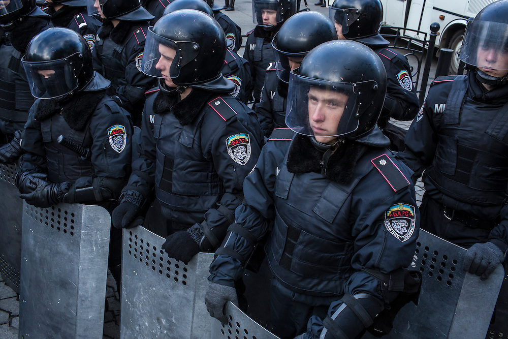 KIEV, UKRAINE - DECEMBER 5: Police guard a street on December 5, 2013 in Kiev, Ukraine. Thousands of people have been protesting against the government since a decision by Ukrainian president Viktor Yanukovych to suspend a trade and partnership agreement with the European Union in favor of incentives from Russia. (Photo by Brendan Hoffman/Getty Images) *** Local Caption ***
