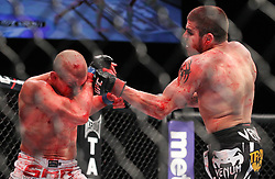 Las Vegas, NV - December 29, 2012: Jim Miller (black/red trunks) and Joe Lauzon (white/blue trunks) during their main card bout at UFC 155 at MGM Grand Garden Arena in Las Vegas, Nevada.