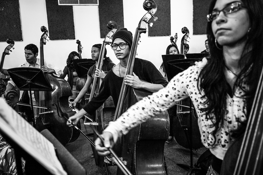 Students learn to play classical music at the El Sistema nucleo in Maracay, Venezuela.