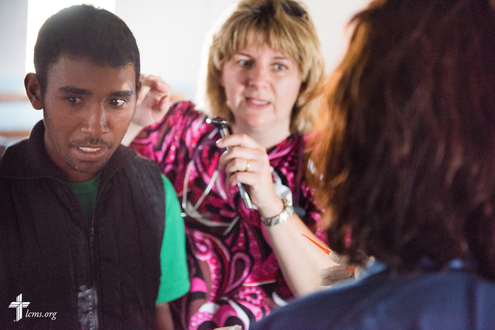 Connie Catron treats a patient at the Mercy Medical Team clinic on Saturday, Oct. 18, 2014, at a Fiangonana Loterana Malagasy (FLM) Lutheran church in Antsoantany, Madagascar. LCMS Communications/Erik M. Lunsford