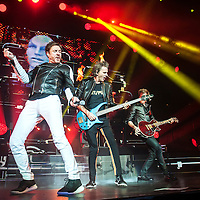 Simon Le Bon,John Taylor, and Nick Rhodes of Duran Duran perform on stage at SEE Hydro on December 06, 2015 in Glasgow,Scotland