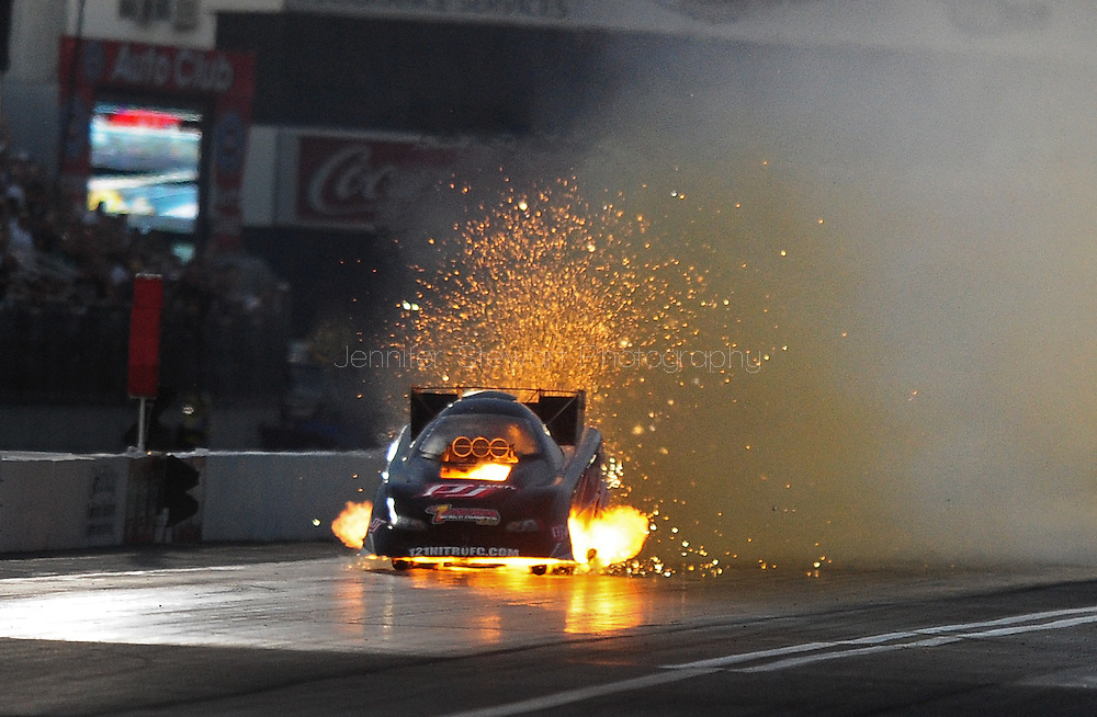 Feb. 13, 2010; Pomona, CA, USA; NHRA funny car driver Terry Haddock engine explodes during qualifying at the Kragen O'Reilly Winternationals at Auto Club Raceway. Mandatory Credit: Jennifer Stewart-US PRESSWIRE