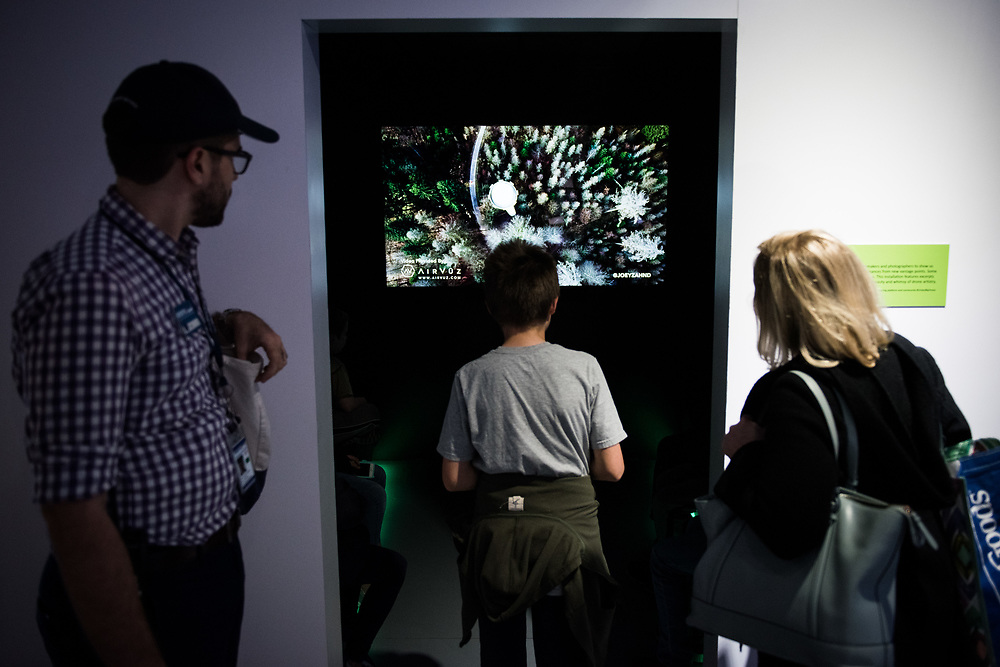 """30206010A - DRONES - Students from Kings Road School in Madison, NJ look watch videos produced using drones at the """"Drones: Is the Sky the Limit?"""" exhibit at the Intrepid Sea, Air, and Space Museum in New York, NY on May 9, 2017."""