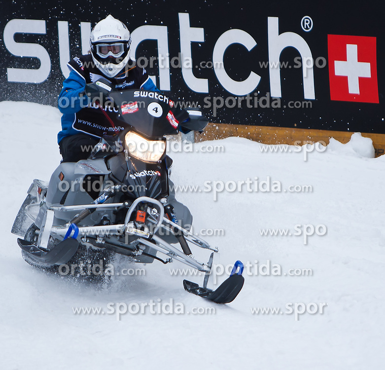 04.12.2010, Rennstrecke, Saalbach Hinterglemm, AUT, Swatch Snow Mobile 2010, im Bild Bild zeigt Teilnehmer vor eine Swatch Bande // a Drive in Front of a Swatch Advert during the Swatch Snow Mobile 2010 Event in Saalbach Hinterglemm, EXPA Pictures © 2010, PhotoCredit: EXPA/ J. Feichter / SPORTIDA PHOTO AGENCY