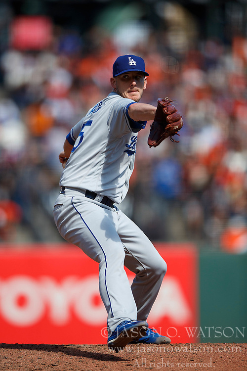 SAN FRANCISCO, CA - OCTOBER 02: Grant Dayton #75 of the Los Angeles Dodgers pitches against the San Francisco Giants during the sixth inning at AT&T Park on October 2, 2016 in San Francisco, California. The San Francisco Giants defeated the Los Angeles Dodgers 7-1. (Photo by Jason O. Watson/Getty Images) *** Local Caption *** Grant Dayton