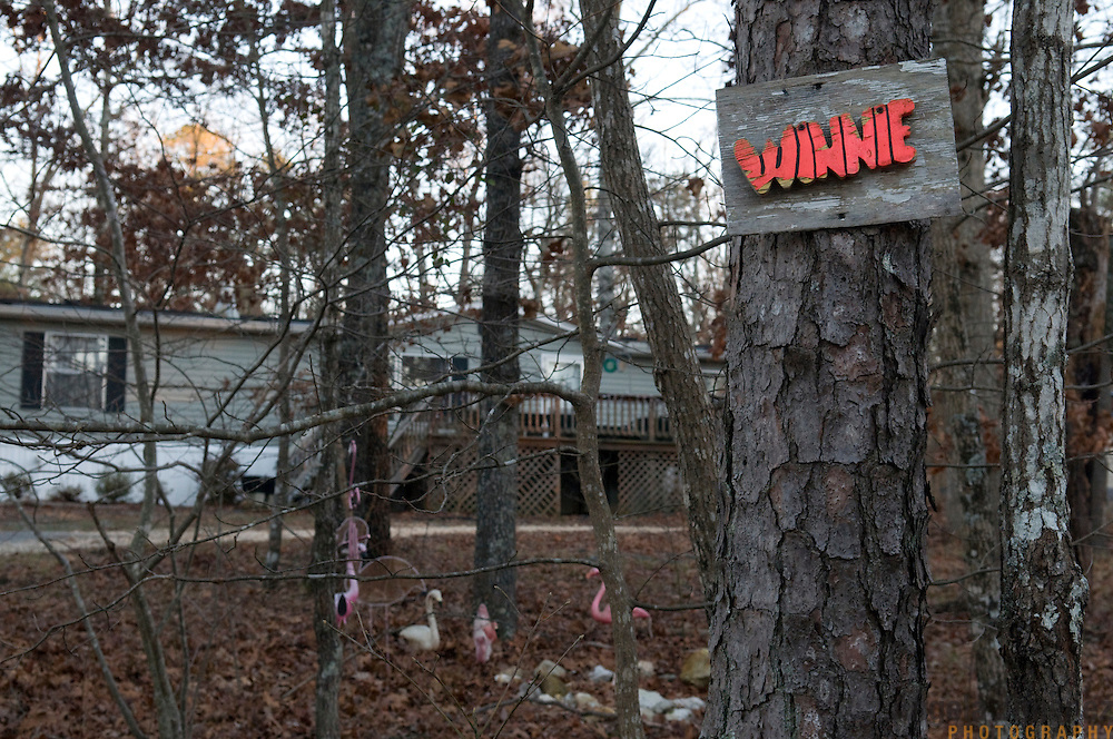 "Date: 1/08/09.Desk: STL.Slug: WOMYN.Assign ID: 30074969A..A sign marks the home of Winnie Adams, 66, at Alapine, a ""womyn's land"" or lesbian intentional community, in rural northeast Alabama. ..(*the exact town/location of the community cannot be revealed in the caption or article, per agreement with the subjects)..Photo by Angela Jimenez for The New York Times .photographer contact 917-586-0916"