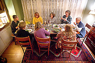 The members of the Books for Cooks Bookclub begin to eat their specially-prepared meals before their meeting, Wednesday, November 19, 2014.
