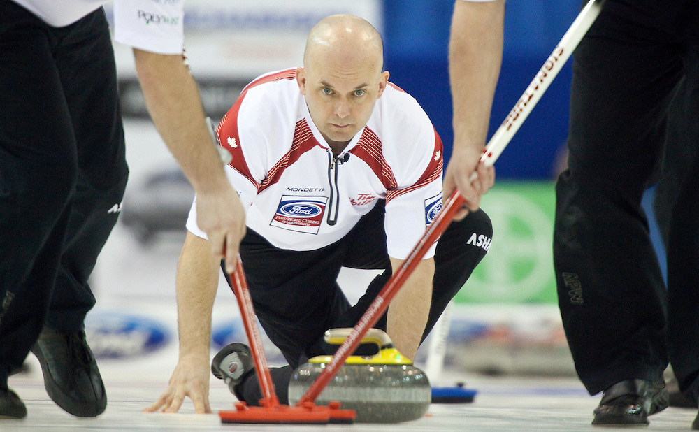 Canadian third Jon Mead delivers his stone during Canada's 5-2 victory over Scotland in the 1-2 playoff match at the Ford World Men's Curling Championships in Regina, Saskatchewan, April 8, 2011.<br /> AFP PHOTO/Geoff Robins