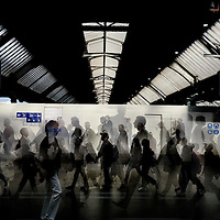 Montage of commuters in Zurich main station.