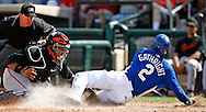 Kansas City Royals Joey Gathright slides into home in a 2008 Spring Training game against the San Francisco Giants.  Royals won 14 to 6.