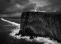 Black and white scene of breaking storm at Dyrholaey, Iceland