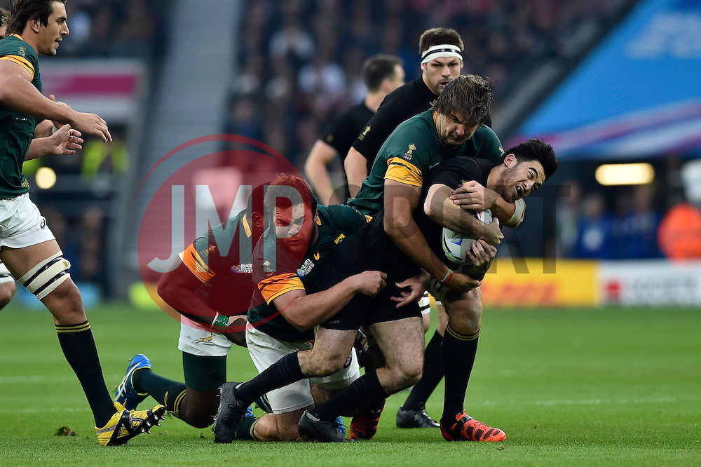 Nehe Milner-Skudder of New Zealand is tackled by the South Africa defence - Mandatory byline: Patrick Khachfe/JMP - 07966 386802 - 24/10/2015 - RUGBY UNION - Twickenham Stadium - London, England - South Africa v New Zealand - Rugby World Cup 2015 Semi Final.