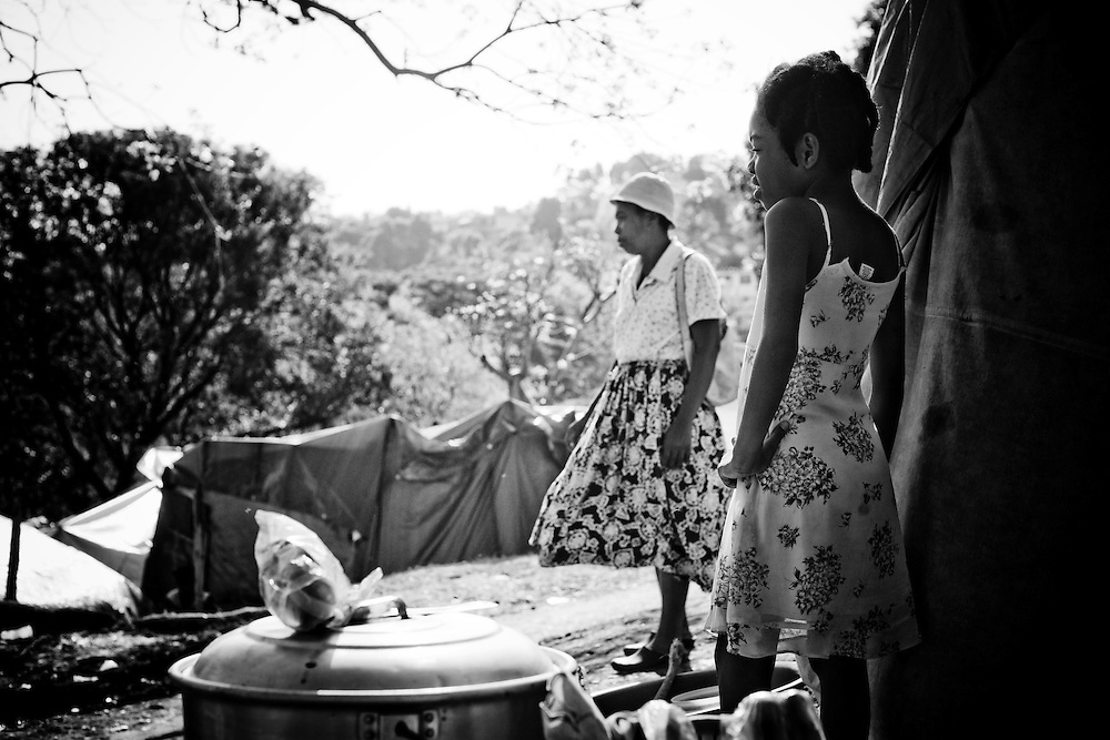 A girl and her mother in a camp for those displaced by the recent earthquake in Petionville, outside Port-au-Prince, Haiti.