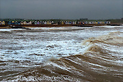 Southwold Pier, Southwold, Suffolk, Britain. Rain and heavy seas on Spring Bank Holiday Monday, 2008. View from the Pier. Beach huts..COPYRIGHT PHOTOGRAPH BY BRIAN HARRIS  © 2008.07808-579804