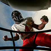 SCOTT MORGAN | ROCKFORD REGISTER STAR.East High School's Martin Hyatte stands over Tyler Free Thursday, Aug. 6, 2009, at East in Rockford.