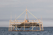 Bagang is a traditional fishing structure  for catching anchovy made of bamboo. A large fishing net in placed on the the sea bottom, light is used to attract the fishes gathering above the net. When this looks promising the net is lifted to collect all the fishes trapped inside the net.