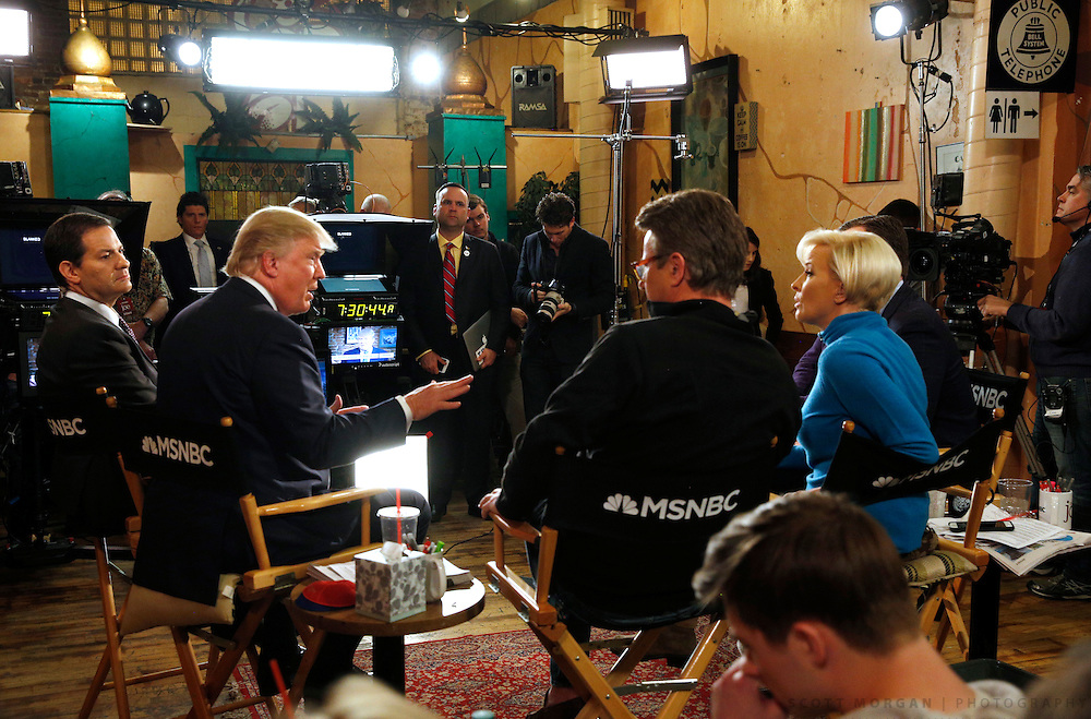 Republican U.S. presidential candidate Donald Trump talks to host Joe Scarborough during an appearance on MSNBC's Morning Joe cable television show at Java Joe's CoffeeHouse in Des Moines, Iowa, January 15, 2016. REUTERS/Scott Morgan
