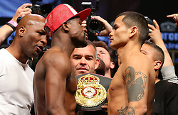 """LAS VEGAS, NV - MAY 2: Floyd """"Money"""" Mayweather Jr. (left) and Marcos Maidana (right) face off after weighing in for their WBA/WBC welterweight championship fight at the MGM Grand Garden Arena on May 2, 2014 in Las Vegas, Nevada. (Photo by Ed Mulholland/Golden Boy/Golden Boy via Getty Images) *** Local Caption ***Floyd Mayweather; Marcos Maidana"""