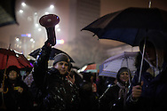 Thousands of protesters braving the rain gather in front of the government headquarters at the Victory square demanding resignation of PM Sorin Grindeanu.  19 February 2017.