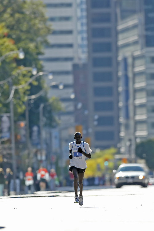 "(Toronto, Ontario -- 18 Oct 2009)   PAUL RUGUT on his way to victory  in the Goodlife Fitness Toronto Marathon. [Photo credit should read ""Sean Burges / Mundo Sport Images""]"