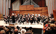 ArtsGala 2012 Chair Colleen Ryan guest conducts as part of the Wind Symphony concert in the brand new Schuster Hall during the 13th Annual ArtsGala at Wright State University's Creative Arts Center, Saturday, March 31, 2012.  Following the piece, director David Booth said with a smile, 'It's a little disheartening each year, when the band plays better for the guest conductor.'