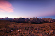 The Earth's shadow and red cirrus clouds are visible over the Rocky Mountains in this view from the highest point of Trail Ridge Road in Rocky Mountain National Park, Colorado.