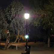 Dimly light walkway that follows the waterway by the London Bridge in Lake Havasu City, Arizona.