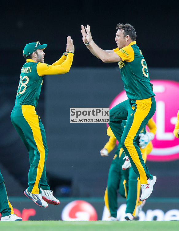 ICC Cricket World Cup 2015 Tournament Match, South Africa v West Indies, Sydney Cricket Ground; 27th February 2015<br /> South Africa&rsquo;s Francois Du Plessis (left) and South Africa&rsquo;s Kyle Abbott celebrate after the wicket of West Indies Marlon Samuels