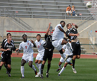 Members of Ohio State and Binghampton go up for the ball from a free kick as OSU takes on Binghamton in the first half of an NCAA men's college soccer game in Columbus, Ohio on Sunday, Sept. 11, 2011, at Jesse Owens Memorial Stadium.