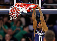SOUTH BEND, IN - JANUARY 12: Ryan Boatright #11 of the Connecticut Huskies dunks the ball against the Notre Dame Fighting Irish at Purcel Pavilion on January 12, 2012 in South Bend, Indiana. Connecticut defeated Notre Dame 65-58. (Photo by Michael Hickey/Getty Images) *** Local Caption *** Ryan Boatright