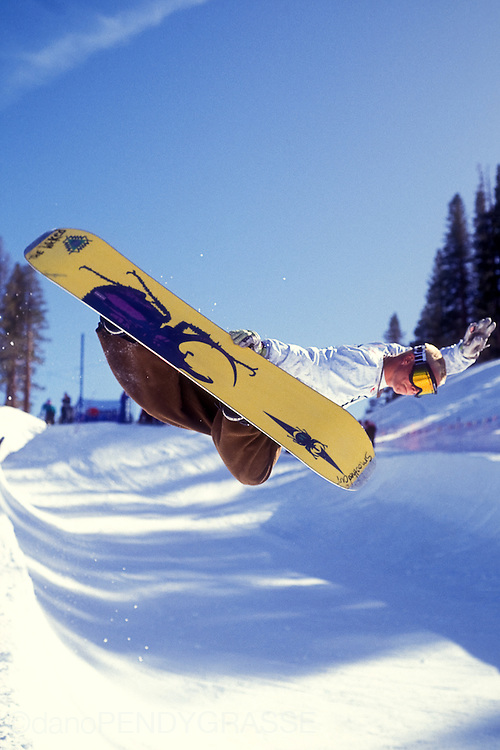 "Fred ""Gilligan"" Yoder cranks a method at the 1993 OP Pro of snowboarding in June Mountain, California."