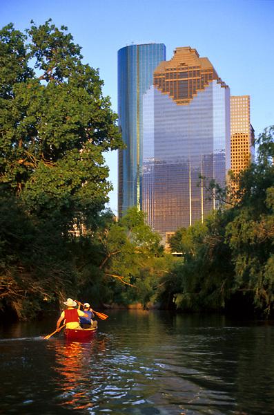 Stock photo of canoeing on Buffalo Bayou with the Houston Skyline in the background
