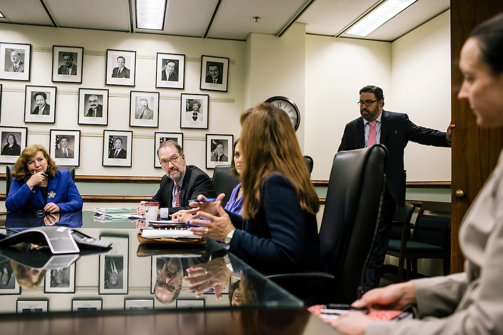 David Weil, center, Administrator of the Wage and Hour Division, holds a meeting with staffers, including Laura Fortman, left, deputy administrator, and Tony Martinez, chief of staff, right, at the U.S. Department of Labor in Washington, D.C.