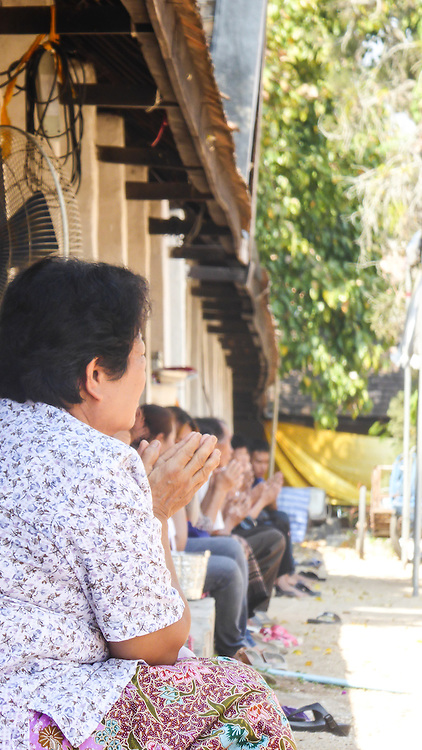 This image was taken by Nukul at Lampan Luang Temple in Thailand. She chose this image because she enjoys the alignment and repetition of the people praying. <br /> <br /> Nukul is Thai Karen and works with the program Daughters Rising in Thailand. She has one young son who often stays in her village while she works. Nukul loves photography and recently took an interest in photographing events.<br /> <br /> &ldquo;I want to have a good job. I want to work for my family to be happy. I want to travel everywhere and go many many countries, like Singapore and New York!! I want to take pictures of people smiling and beautiful scenery when I travel.&rdquo; - Nukul