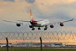 A Virgin Atlantic Airbus A340 prepares to land on runway 27R at London's Heathrow Airport (LHR / EGLL).