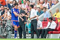 EINDHOVEN - PSV - Feyenoord , Voetbal , Seizoen 2015/2016 , Eredivisie , Philips Stadion , 30-08-2015 , Speler van Feyenoord Eric Botteghin (l) moet geblesseerd het veld verlaten en krijgt een hand van Feyenoord trainer Giovanni van Bronckhorst (r)