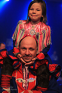 Father carries daughter on his shoulders at the Sami Grand Prix concert in the Batkeharji auditorium at the Sami Easter Festival in Kautokeino, Finnmark, Norway.