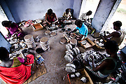 Workers working in a small room inside the factory.The rooms in the factories are usually overloaded with workers where only 2 to 3 persons are allowed based on the amount of gunpowder used.These is one of the major reason for deaths during accidents. Image © Balaji Maheshwar/Falcon Photo Agency
