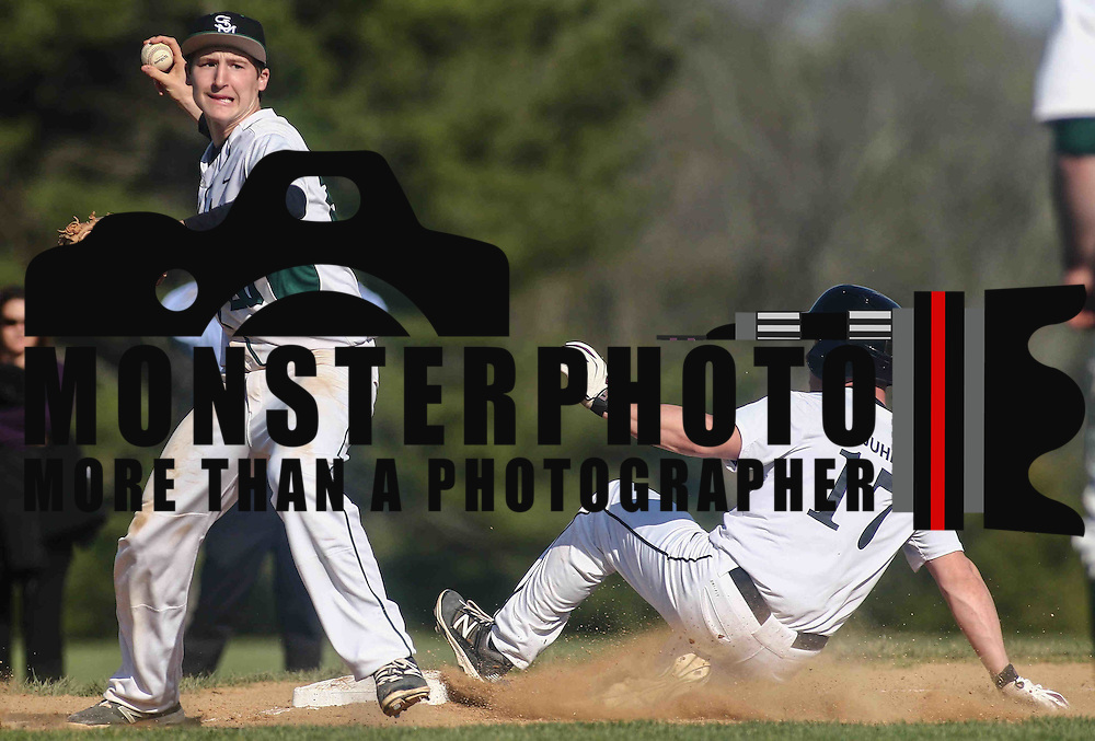 Caravel Academy Infielder Tyler Juhl (17) slides into third base safely during a regular season baseball game between the St. Marks Spartans and Caravel Academy at St. Marks Stadium Thursday April 14, 2016 in Wilmington.