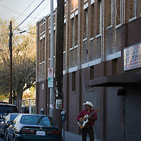 A lone mariachi strums his guitar in East LA. Please contact Todd Bigelow directly with your licensing requests.