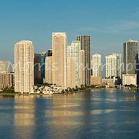 This version is watermarked, contact us to license and clean version. Aerial panorama of downtown Miami from the east over Biscayne Bay, featuring Bayfront Park, the entrance to the Miami River and Brickell Key.