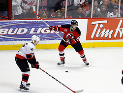 April 26, 2007; East Rutherford, NJ, USA; New Jersey Devils wing Travis Zajac (19) takes a shot during the third period at Continental Airlines Arena in East Rutherford, NJ.