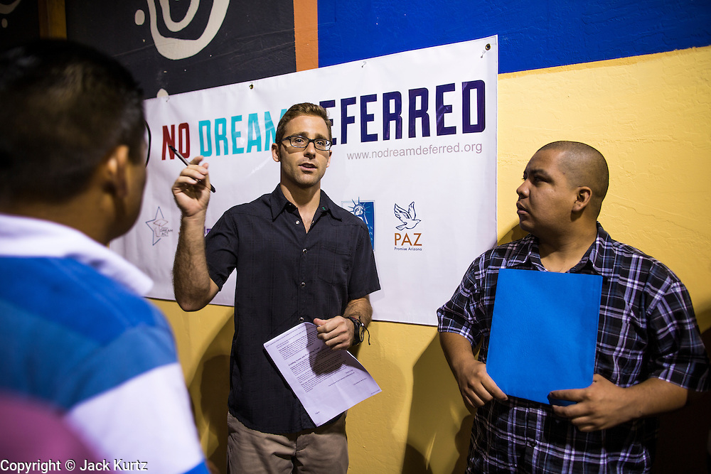 """18 AUGUST 2012 - PHOENIX, AZ:  JOHNNY SINODIS, an immigration and criminal defense lawyer, talks to young people about the """"deferred action"""" program during a deferred action workshop in Phoenix. More than 1000 people attended a series of 90 minute workshops in Phoenix Saturday on the """"deferred action"""" announced by President Obama in June. Under the plan, young people brought to the US without papers, would under certain circumstances, not be subject to deportation. The plan mirrors some aspects the DREAM Act (acronym for Development, Relief, and Education for Alien Minors), that immigration advocates have sought for years. The workshops were sponsored by No DREAM Deferred Coalition.  PHOTO BY JACK KURTZ"""
