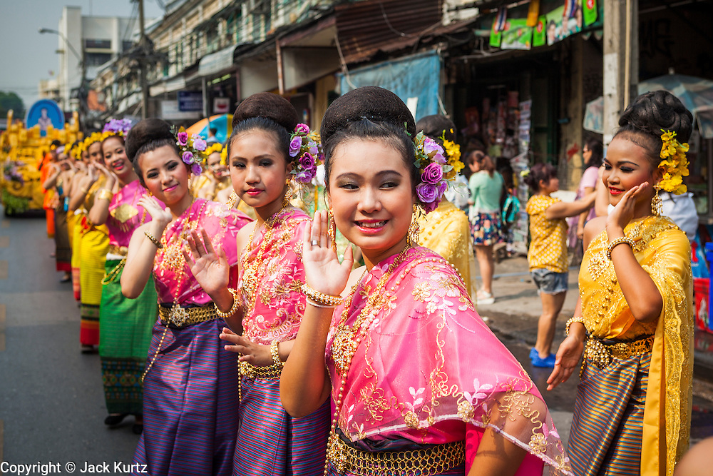 13 APRIL 2014 - BANGKOK, THAILAND:  Traditional Thai dancers in a Songkran parade near Khao San Road, Bangkok's backpacker street. Songkran is celebrated in Thailand as the traditional New Year's Day from 13 to 16 April. Songkran is in the hottest time of the year in Thailand, at the end of the dry season and provides an excuse for people to cool off in friendly water fights that take place throughout the country. Songkran has been a national holiday since 1940, when Thailand moved the first day of the year to January 1.      PHOTO BY JACK KURTZ