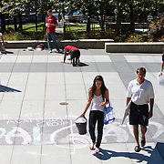 08/29/2012 - Medford/Somerville, Mass. - Families pass Tisch Library as JumpStart students chalk the patio on the morning of Wednesday, Aug. 29, 2012. (Kelvin Ma/Tufts University)