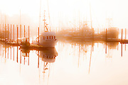 Misty morning fishing boats at Newport Oregon
