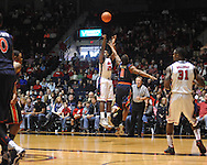 "Ole Miss' Nick Williams (20) shoots over Auburn guard Josh Wallace (11) at the C.M. ""Tad"" Smith Coliseum on Saturday, February 23, 2013."