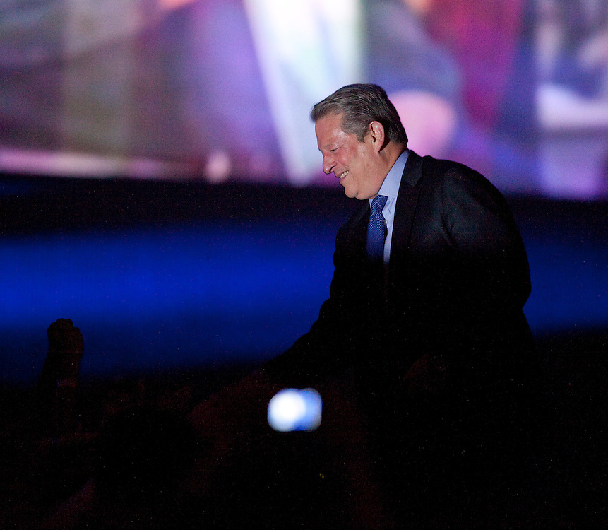 Former U.S. Vice President and environmental crusader Al Gore shakes hands with members of the audience at Free the Children's We Day celebrations in Kitchener, Ontario, Thursday, February 17, 2011. We Day was started to celebrate the power of young people. <br /> The Canadian Press/GEOFF ROBINS