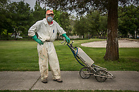 """Volunteer Dick Engelhard prepares to spray the greens at the Calistoga Golf Course.  """"This is perfect...no one will ever recognize me."""""""